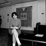 Joyce Wieland seated in the Isaacs Gallery, 1967.