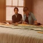 Joyce Wieland (left) laying out the Caribou Quilt now located at Spadina Station on the TTC.