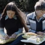 Two assistants assemble Joyce Wieland's quilt, 1977