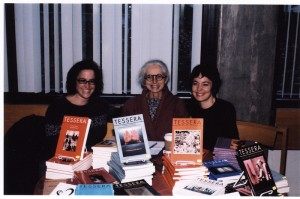 Julie Murray, Barbara Godard and Jennifer Henderson posing with TESSERA series at the LeftWord Book Fair, October 2001. From Tessera fonds, image number ASC07028.
