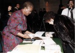 Participants signing a guest book at the first federal celebration of Black History Month, 13 February, 1996. Image no. ASC04451.