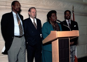 Jean Augustine speaking at first federal celebration of Black History Month, flanked by Prime Minister Jean Chretien and MP Ovid Jackson, 13 February, 1996. Image no. ASC04453.