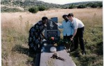 Jean Augustine with fellow MP Svend Robinson at the grave site of South African activist grave site of Steven Biko, with Biko's wife, Ntsiki Mashalaba, April 1994. Image no. ASC04495.