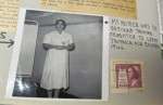 "Portrait of Gerald Archambeau's mother Phyllis, a registered nurse, standing in her uniform, holding a certificate wrapped in ribbon. Caption by Archambeau reads: ""MY MOTHER WAS THE SECOND THOMAS DAUGHTER TO LEAVE JAMAICA FOR CANADA. 1946."" There is a 5 cent stamp pasted to the right of the photograph featuring a nurse and the motto ""Health Guards A Nation 