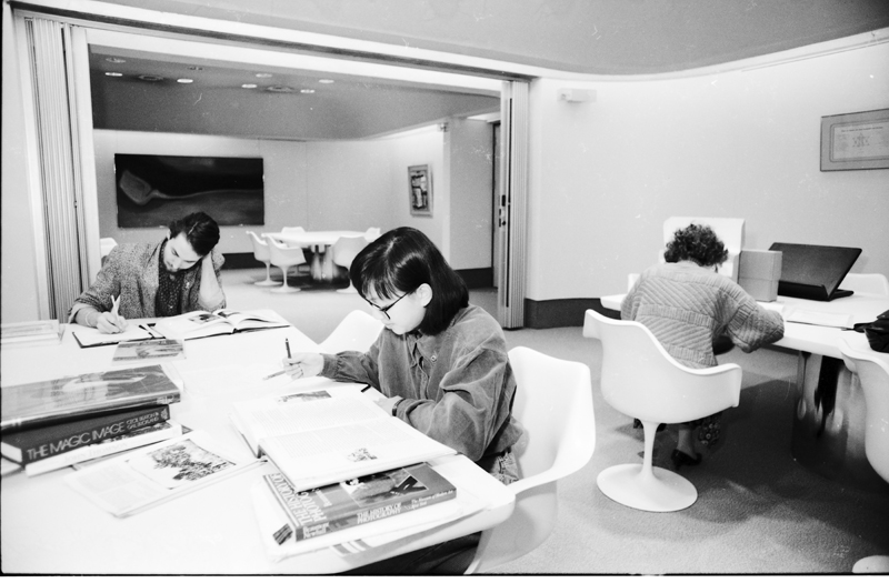 Image of three researchers working in the reading room of the Clara Thomas Archives & Special Collections, York University Libraries. Image no. ASC05083.