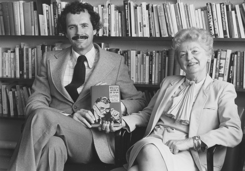 Image of Clara Thomas and John Lennox holding a copy of William Arthur Deacon: a Canadian literary life,1982 Clara Thomas fonds, F0432, image no. ASC00504.