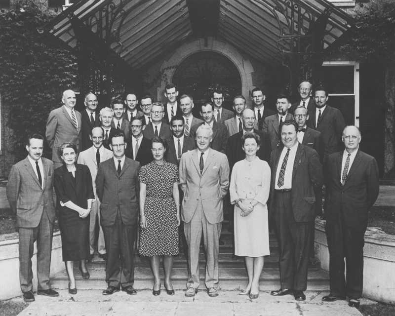 Image of York faculty and administrative officers 1961-1962, in front of Glendon Hall. Front row: Douglas Lochhead, Alice Turner, David Fowle, Edith Guild, Murray Ross, Clara Thomas, Geroge Harjan, Edgar McInnis. Second row: John Seeley, George Tatham, Norman Endler, Irvine Pounder, John Armour. Back row: Lloyd Jenkins, Howard Langille, Lester Pronger, Robert Lundell, Arthur Johnson, Douglas Verney, Hugh Maclean, Craufurd Goodwin, Donald Jackson, John McFarland, Denis Smith, Vello Sermat, Donald Rickers, John Bruckmann, Neil Morrison, Lionel Rubinoff. York University photograph collection, F0091, image no. ASC02058.