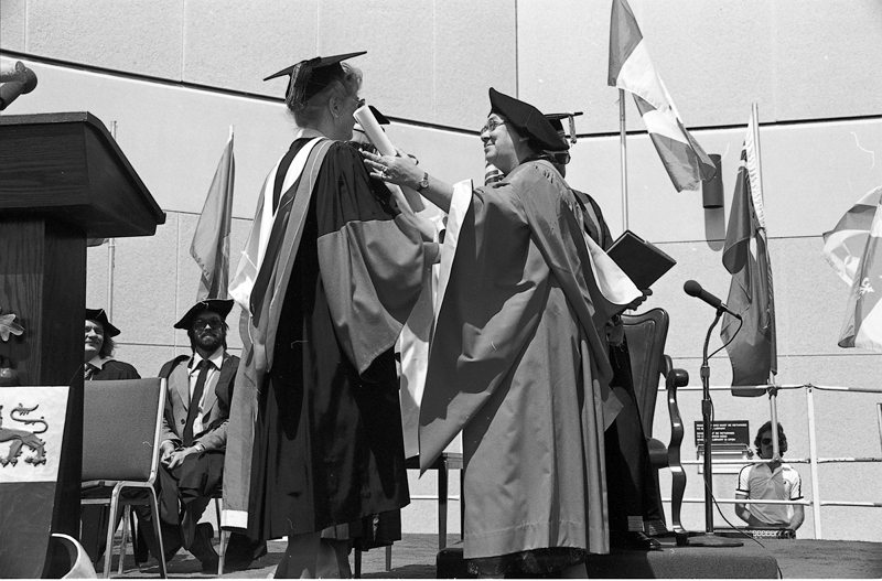 Image of Prof. Clara Thomas (left) and honorary degree recipient, author Margaret Laurence (right), June 1980. Computing & Network Services fonds, F0477, image no. ASC04593.