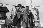 Image of Prof. Clara Thomas (left) is embraced by honorary degree recipient, author Margaret Laurence (right), June 1980. Computing & Network Services fonds, F0477, image no. ASC04594.