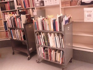 Two rolling carts full of books and pamphlets for addition to the Special Collections.