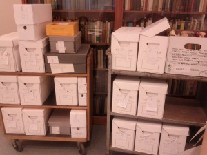 Two carts containing many boxes of archival material.