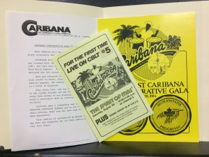 Image of an opened file folder with three documents, two yellow, on Caribana.